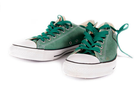Pair of green sneakers isolated on white background photo