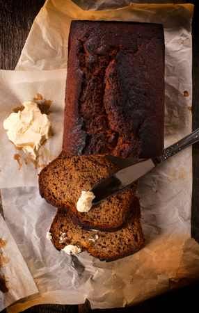Bananas bread and butter on the table,from above photo