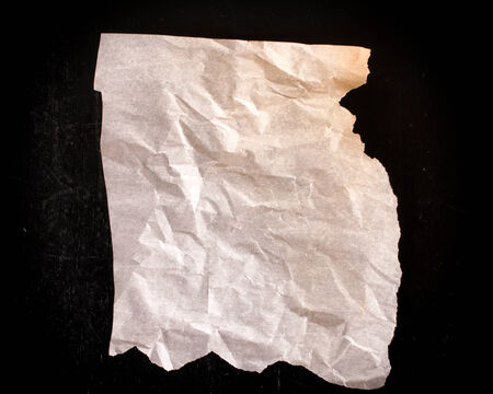 rumple: Wrinkled blank paper on black wooden background Stock Photo