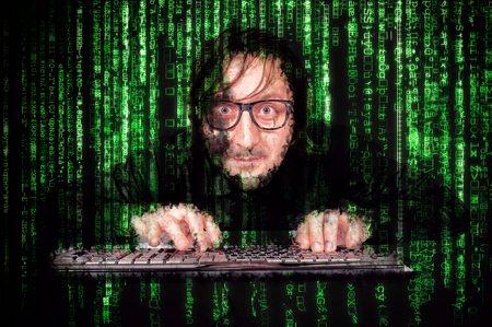 Hacker in Action on the keyboard  with matrix background photo