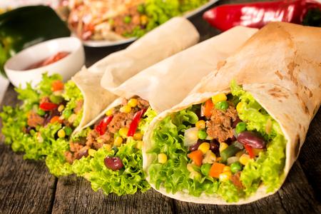latin food: Selective focus on the right burrito sandwich  Stock Photo