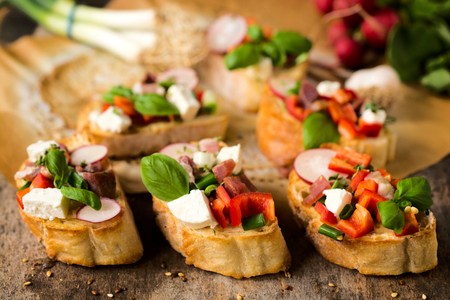 Traditional Italian bruschettas with cheese and vegetables photo
