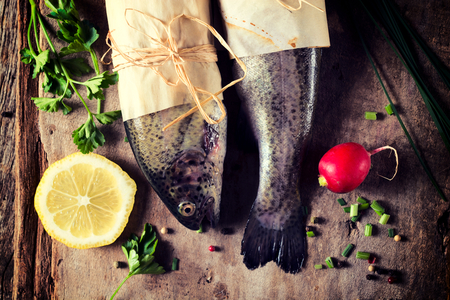 smal: Fish head and tail from above on the wooden table  Stock Photo