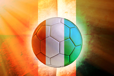 Soccer ball with Ivory Coast flag as the background photo