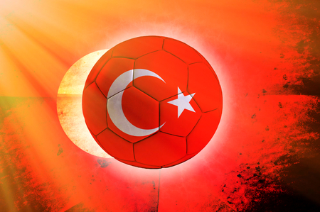 Soccer ball with Turkish flag as the background photo