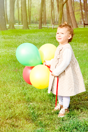 Child holding colorful balloons.Selective focus on the child photo