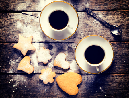 Two cups of black coffee and homemade cookies with different shapes  photo