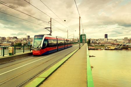 public transport: Modern tram on the bridge in Belgrade city.Blurred motion of tram Editorial