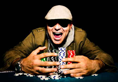 poker table: Man winning on the poker game.Selective focus on the man head