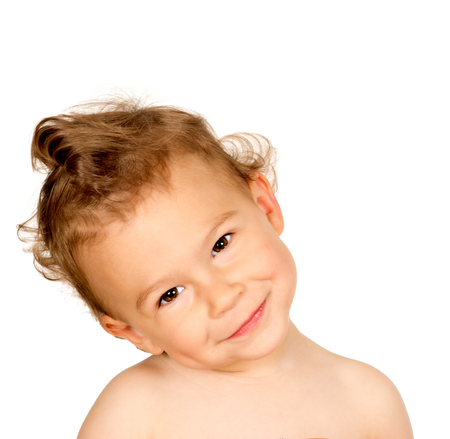 Little child with cuddly face isolated on white background photo