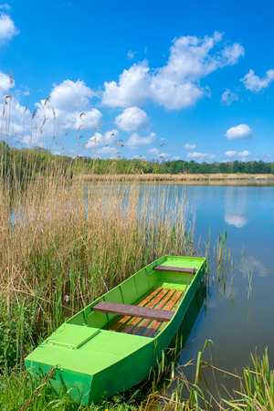 Green barge on the Deliblat lake in Vojvodina region,Serbia photo