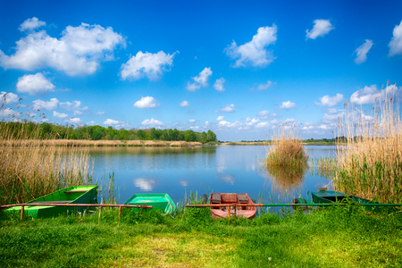 Landscape of the lake and small boats in hdr technique  photo