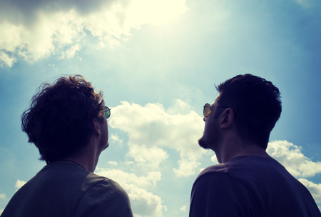 Two man watching on the sky and sun  photo