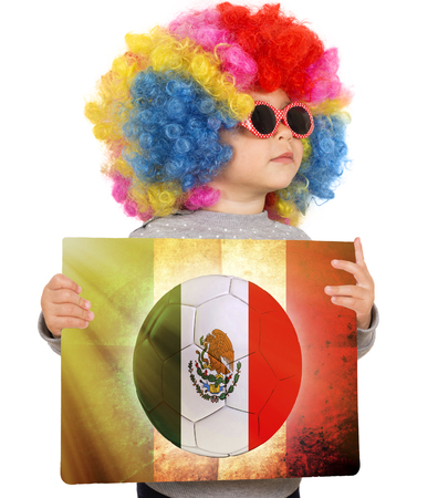 wig: Little child with clown wig support Mexican team Stock Photo