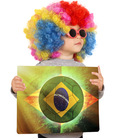 Little child with clown wig support Brazilian team photo