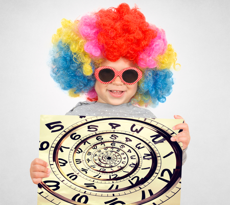Happy child with clown wig holding the clock in drost effect  photo