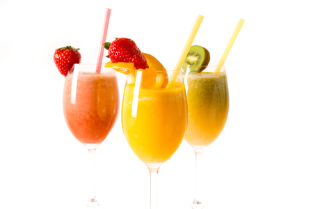 Fresh fruith smoothies in the glass.Selective focus on the front glass photo