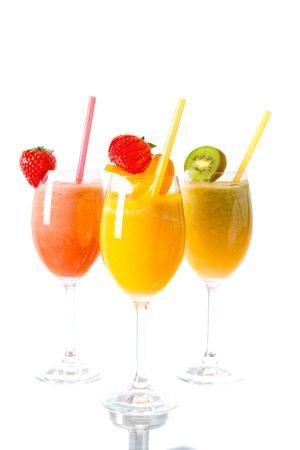 Fresh fruit smoothies in the glass.Selective focus on the front glass photo