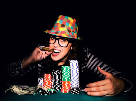 Happy female face on the poker game.selective focus on the female head  photo