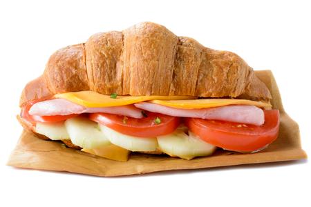 Big croissant sandwich isolated on white background photo