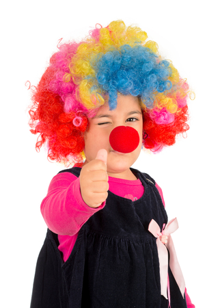 Portrait of positive little clown wit thumb up isolated photo