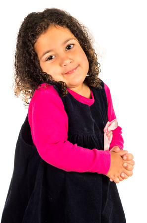 playful behaviour: Beautiful little girl with curly hairstyle isolated Stock Photo