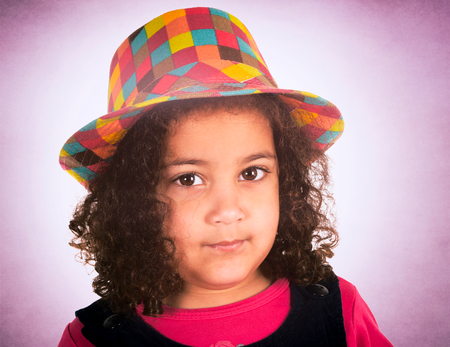 Portrait of beauty little girl with colorful hat photo