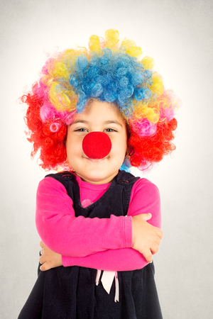 Happy little clown with crossed hands  photo