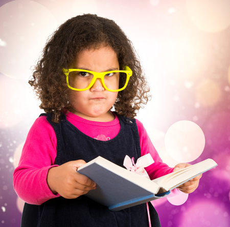 open trench: Little angry child holding the book  Stock Photo