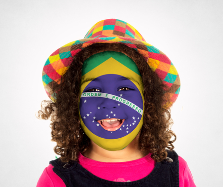 Portrait of child with Brasilian mask on her face photo