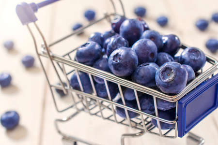 food stores: Selective focus on the front blueberry in trolley Stock Photo