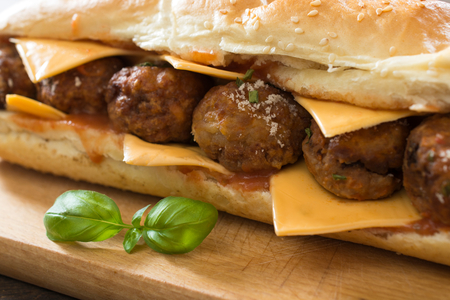 hero sandwich: Selective focus on meatball in the middle in sandwich