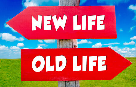 destined: Old and new lifes concept on the red signs with landscape in background Stock Photo