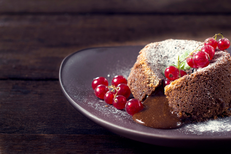 cream cakes: Chocolate pudding cake and red currants, selective focus  Stock Photo