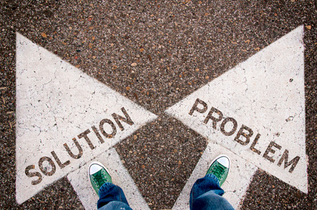 business dilemma: Solution and problem dilemma concept with man legs from above standing on signs Stock Photo