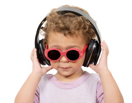 Beautiful cute happy little girl with headphones photo