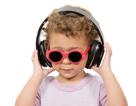Beautiful cute happy little girl with headphones photo