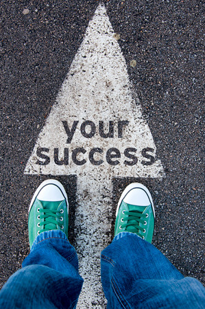 sucess: Green shoes standing on your success sign