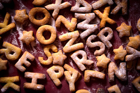 Cookies with letters shapes and sugar powder photo