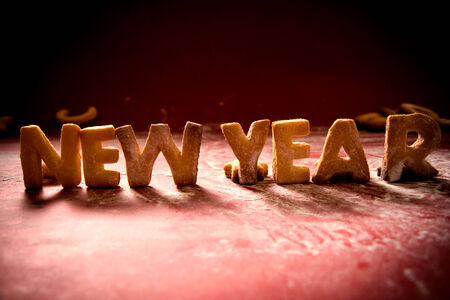 New Year cookies with sugar powder on red background  photo