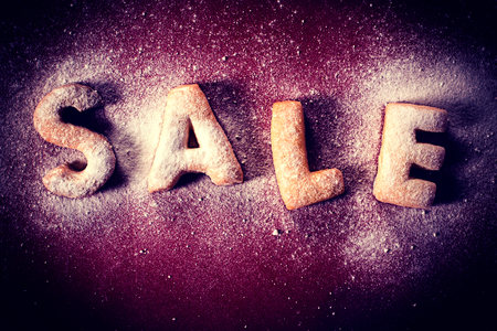 bake sale sign: Sale sign written with cookies on the abstract background