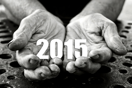 cupped hands: Open hands holding number 2015. Happy New Year. Selective focus on fingers.