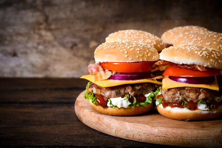 Beef burgers on the wooden background with blank space on left ide Stok Fotoğraf