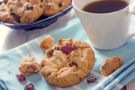 Dry cranberry cookies and coffee cup,selective focus Stock Photo
