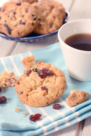 Dry cranberry cookies and coffee,selective focus