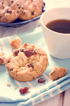 Sweet dry cranberry cookies and cup of coffee,selective focus