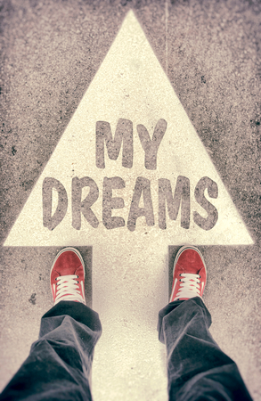 Brand new red shoes from above standing on my dreams sign photo