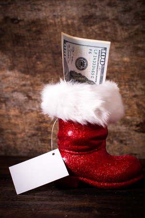 Red santa boots with money and blank card photo
