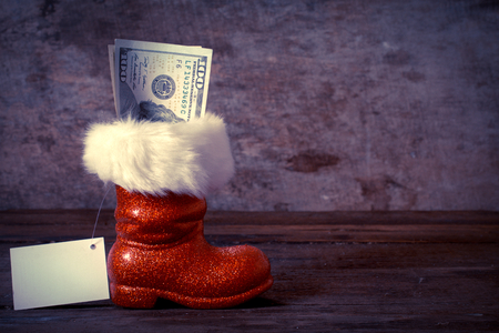 Traditional Christmas Santa boot stuffed with the money photo