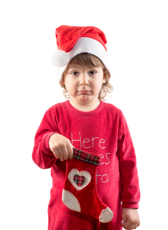 curtsy: Funny little child holding empty Christmas sock isolated on white background Stock Photo
